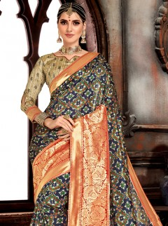 Adorning Dark Blue Colour Patora Saree
