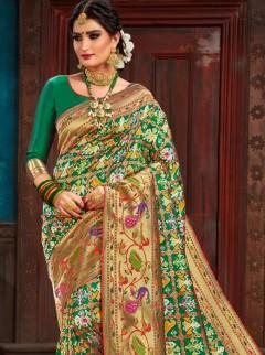 Astounding Green And Gold Colour Patora Saree